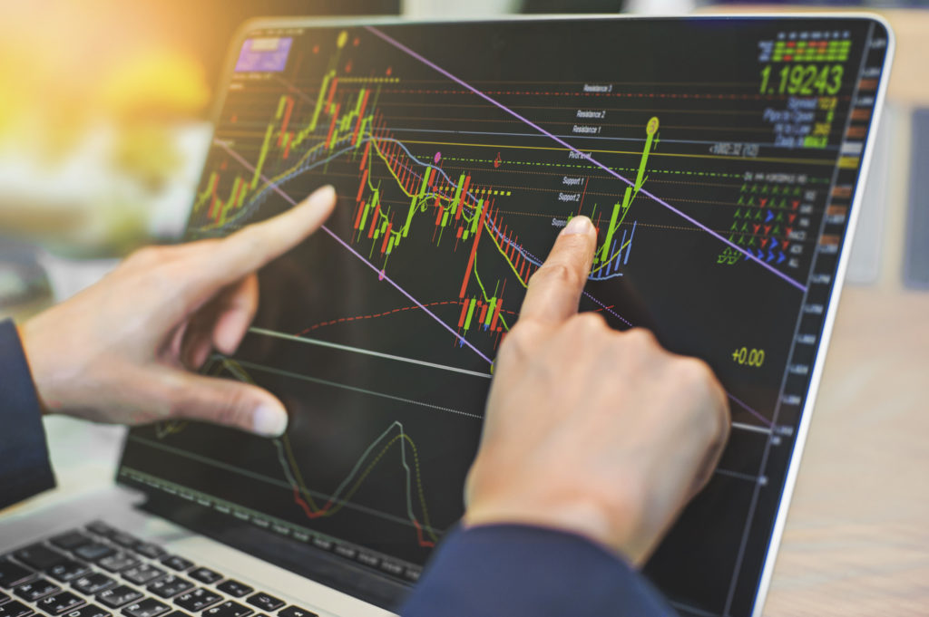 man trading stocks on his computer