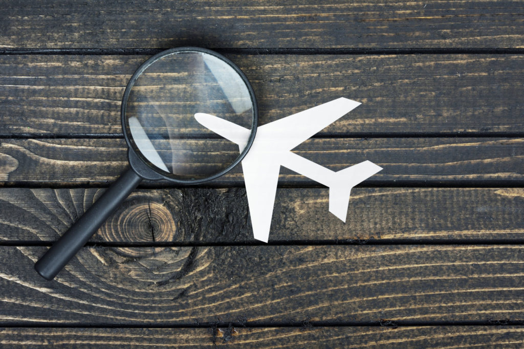 airplane with magnify glass