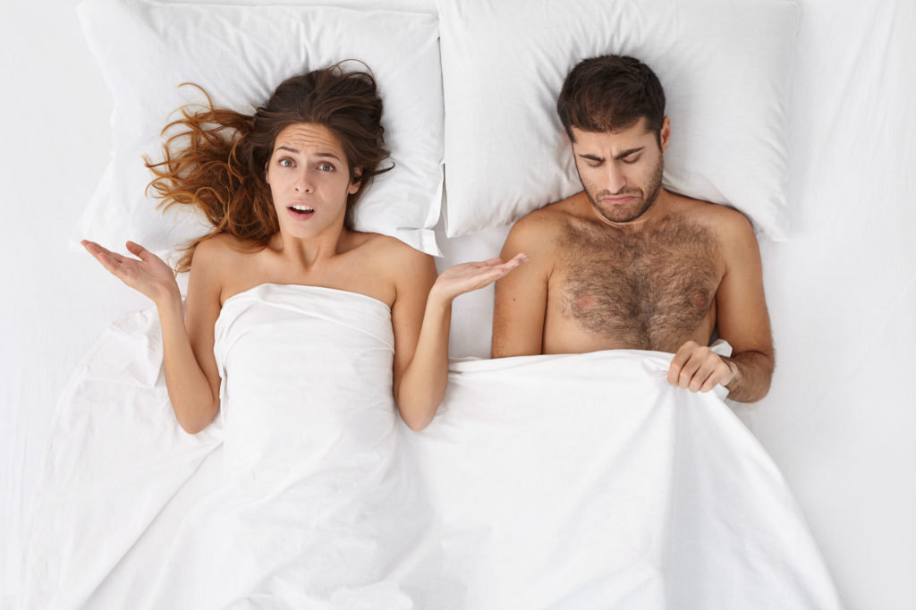 couple laying in bed talking
