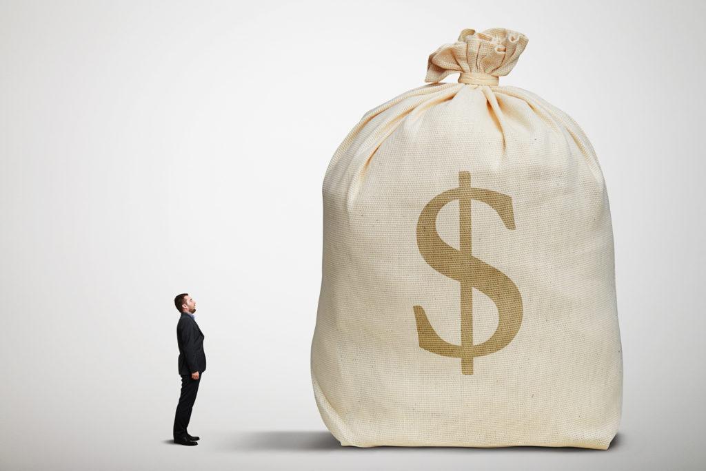 man looking a a big money bag